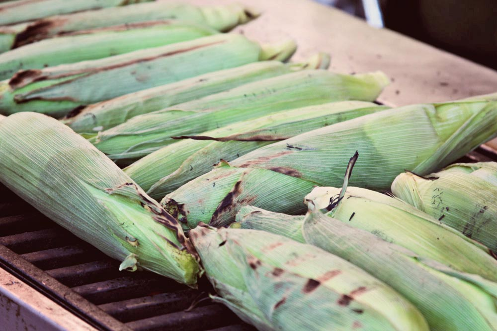 Rehearsal dinner - fresh corn on the cob on the grill. [Delicata Catering]
