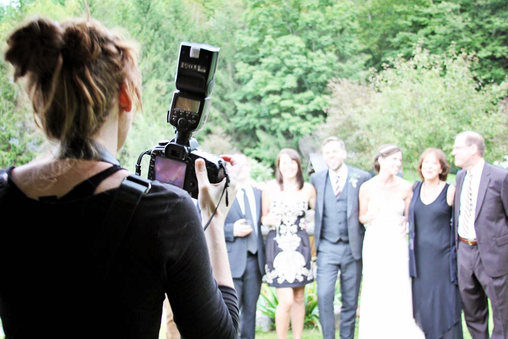 Riverside Farm Vermont - the wedding party being photographed by In Tandem
