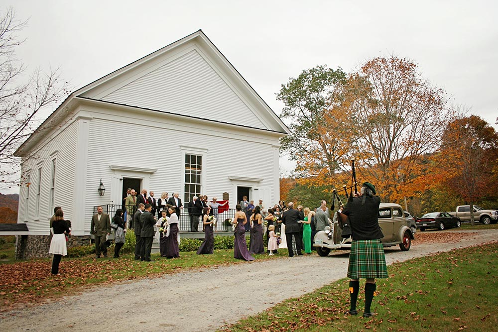 Real Amee Farm Fall Wedding - bagpiper at historic Stockbridge Meeting House