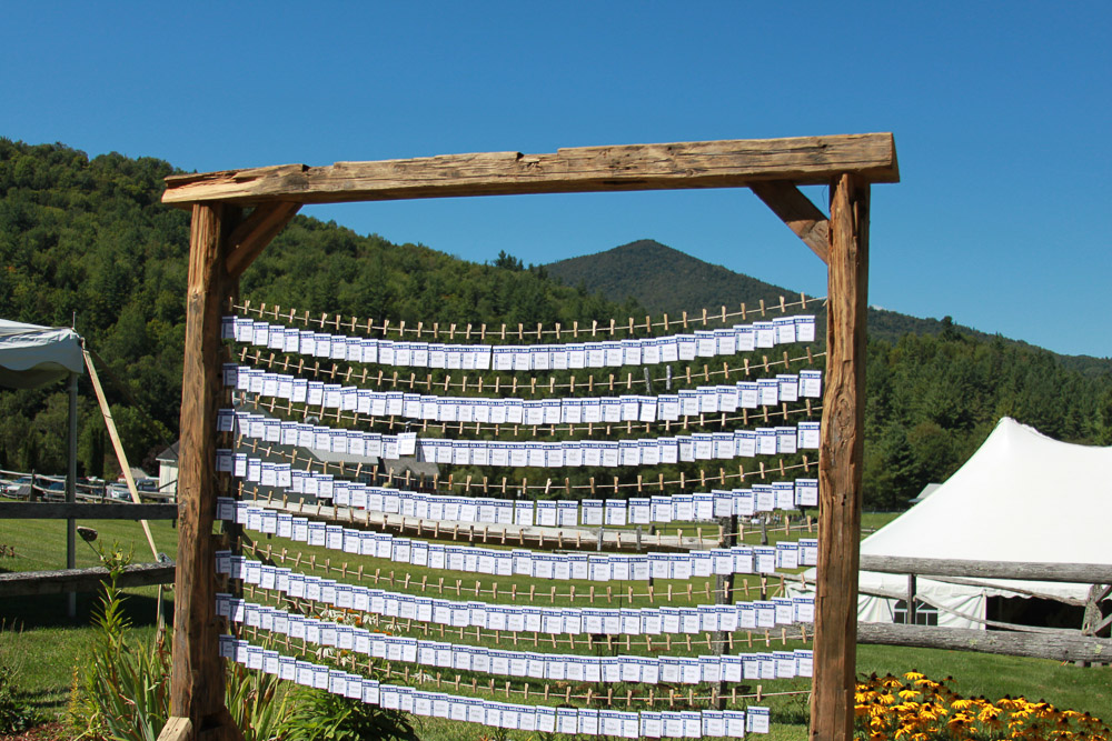 Rustic clothes line themed wedding place card display