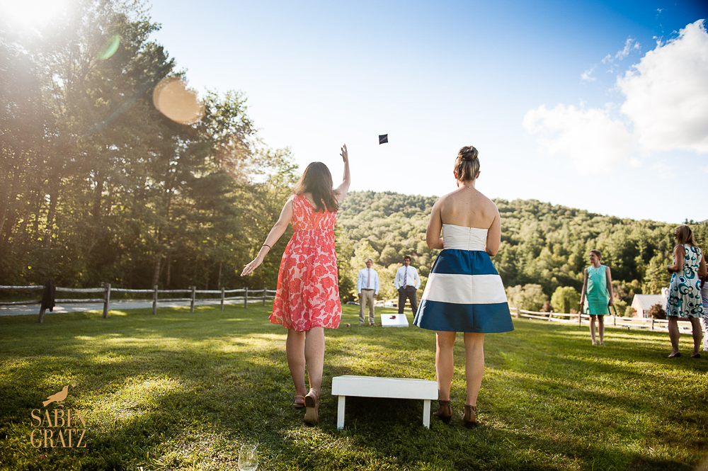 Wedding Guests Enjoy Lawn Games at Riverside Farm - photo Sabin Gratz