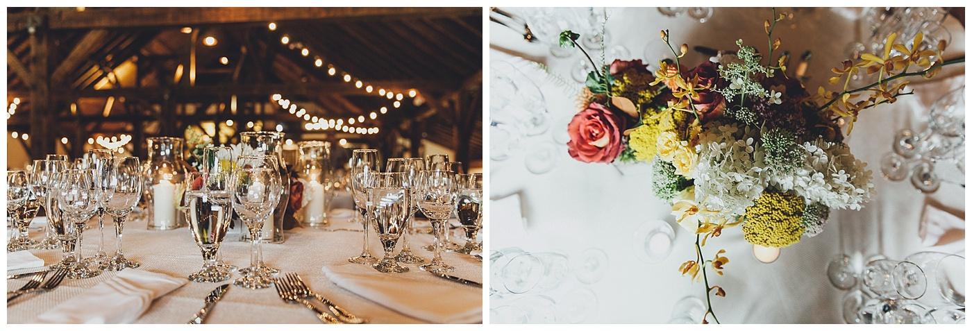 Wedding reception tables settings in Riverside Farm's Brown Barn.